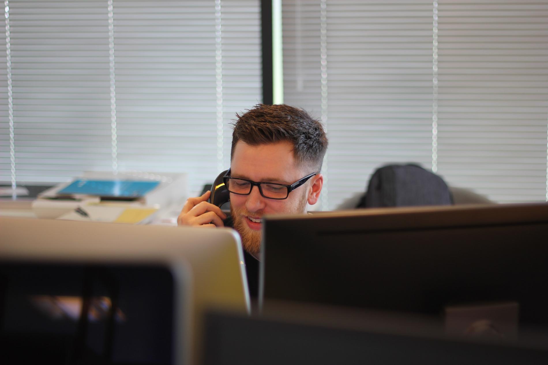 Man using a desk phone
